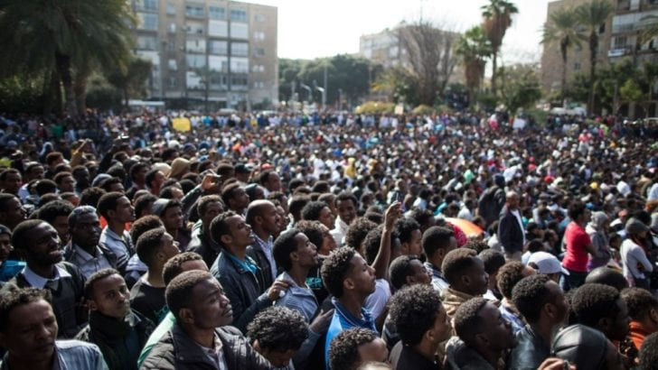 Tens of thousands of migrants to Israel protest in Tel Aviv, January 2014, calling for status as refugees or asylum status. [Uriel Sinai/Getty]