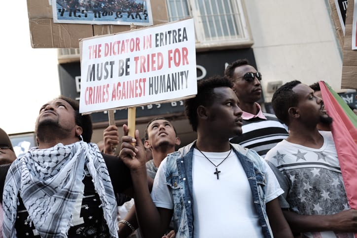Eritrean migrants protest in front of the European Union embassy in Ramat Gan, near Tel Aviv, calling for the EU to try the Eritrean leadership for crimes against humanity, on June 21, 2016. Photo by Tomer Neuberg/Flash90