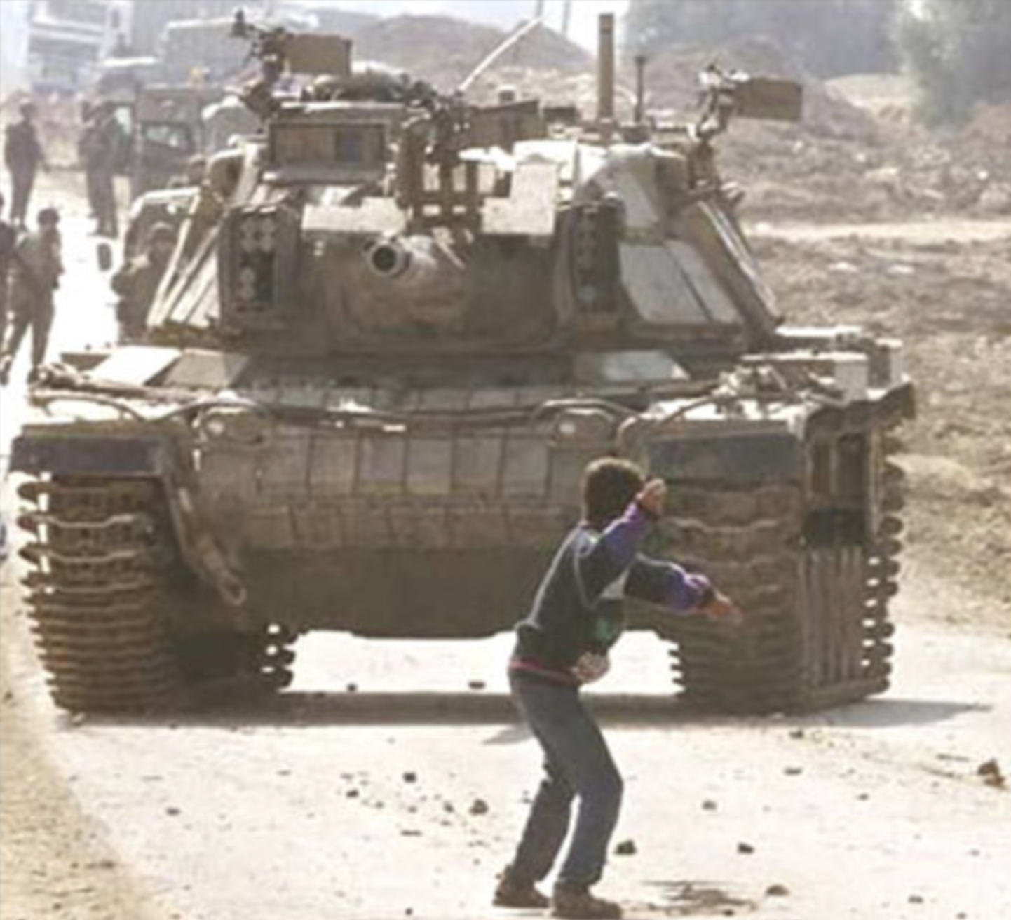 Faris Odeh stood alone in front of a tank on October 29, 2000 with a stone in his hand, when a photojournalist from AP took his picture. Ten days later, he was throwing stones again when he was shot in the neck by Israeli troops. The boy and the image subsequently assumed iconic status as a symbol of opposition to the Israeli occupation. Faris died a few days after the shooting.