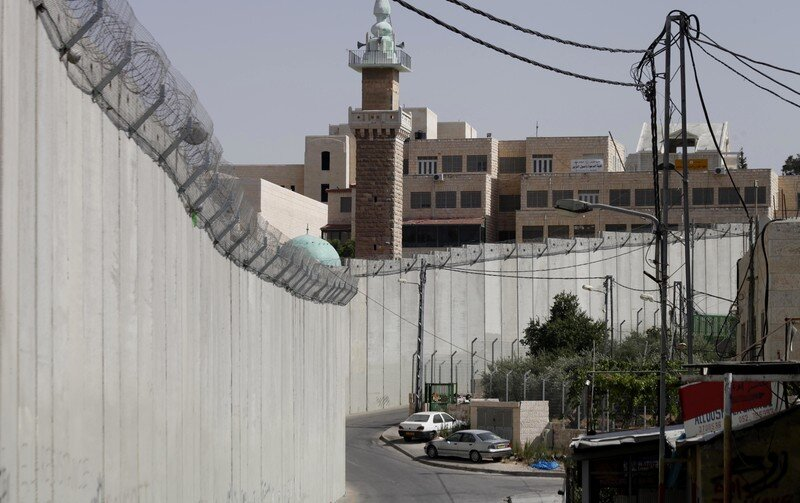 Was it Israel's wall or a Palestinian ceasefire that stopped suicide bombings? Saeed QaqAPA images