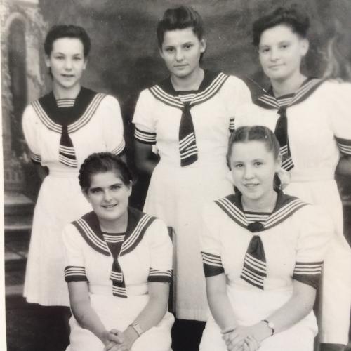 Ada (bottom L) with classmates in Tengeru