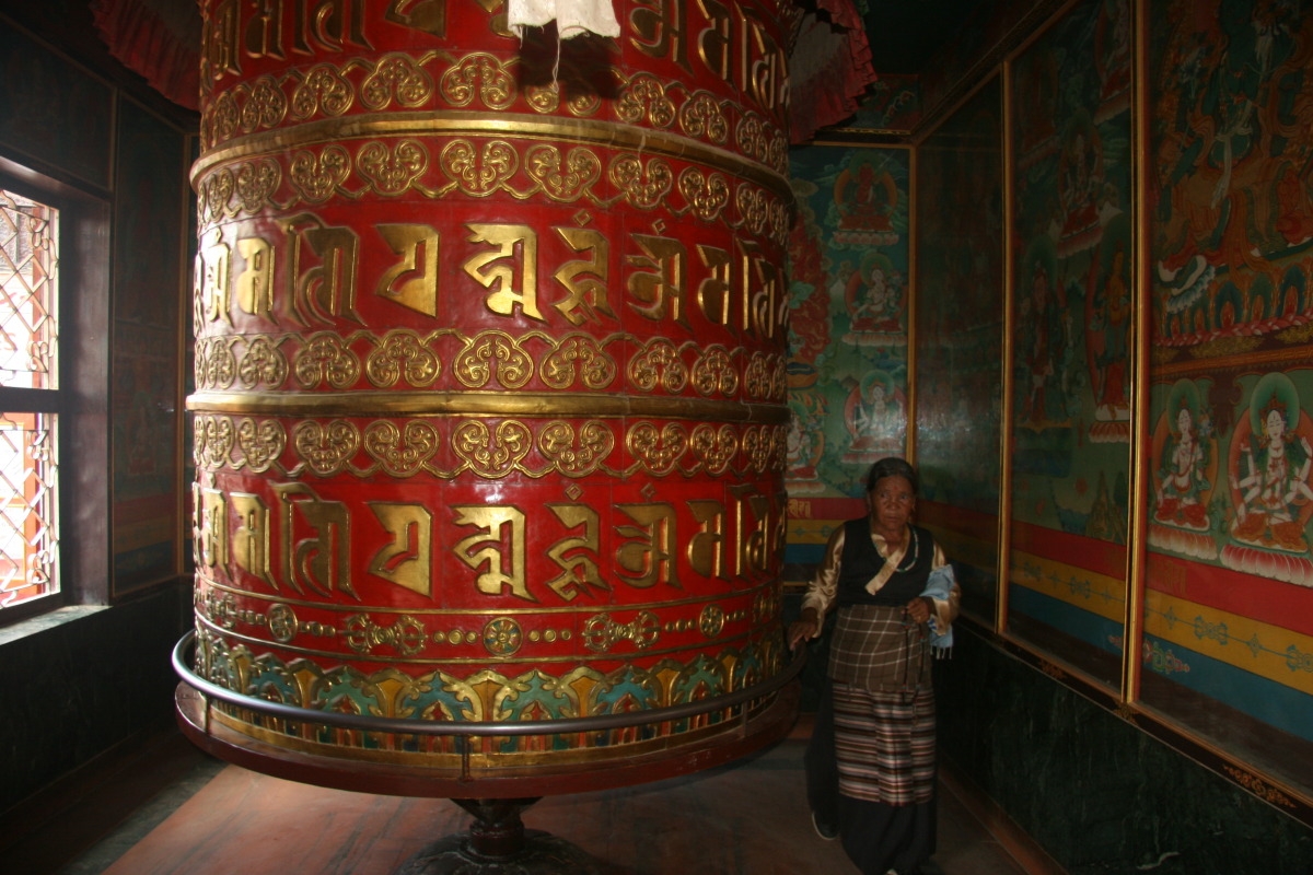 Large prayer wheel in Tibetan temple at Boudhinath