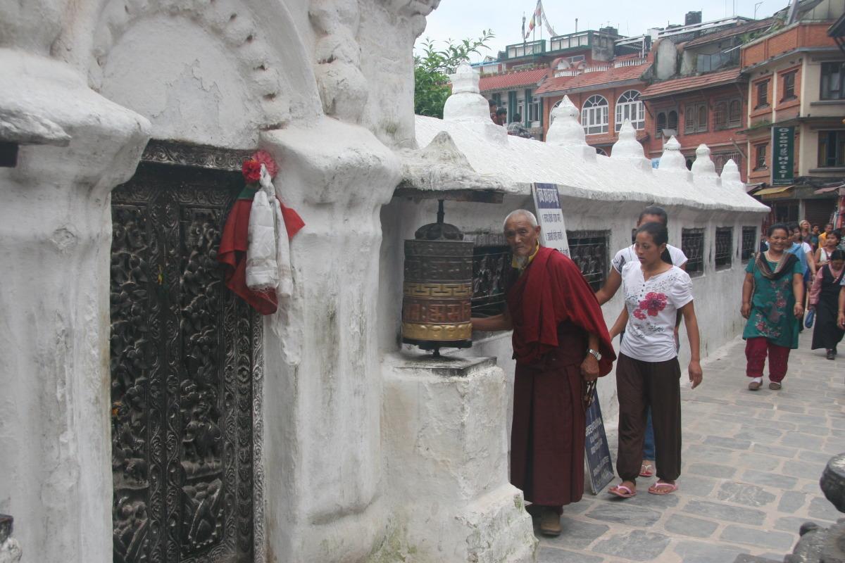 Tibetan man and prayer wheel
