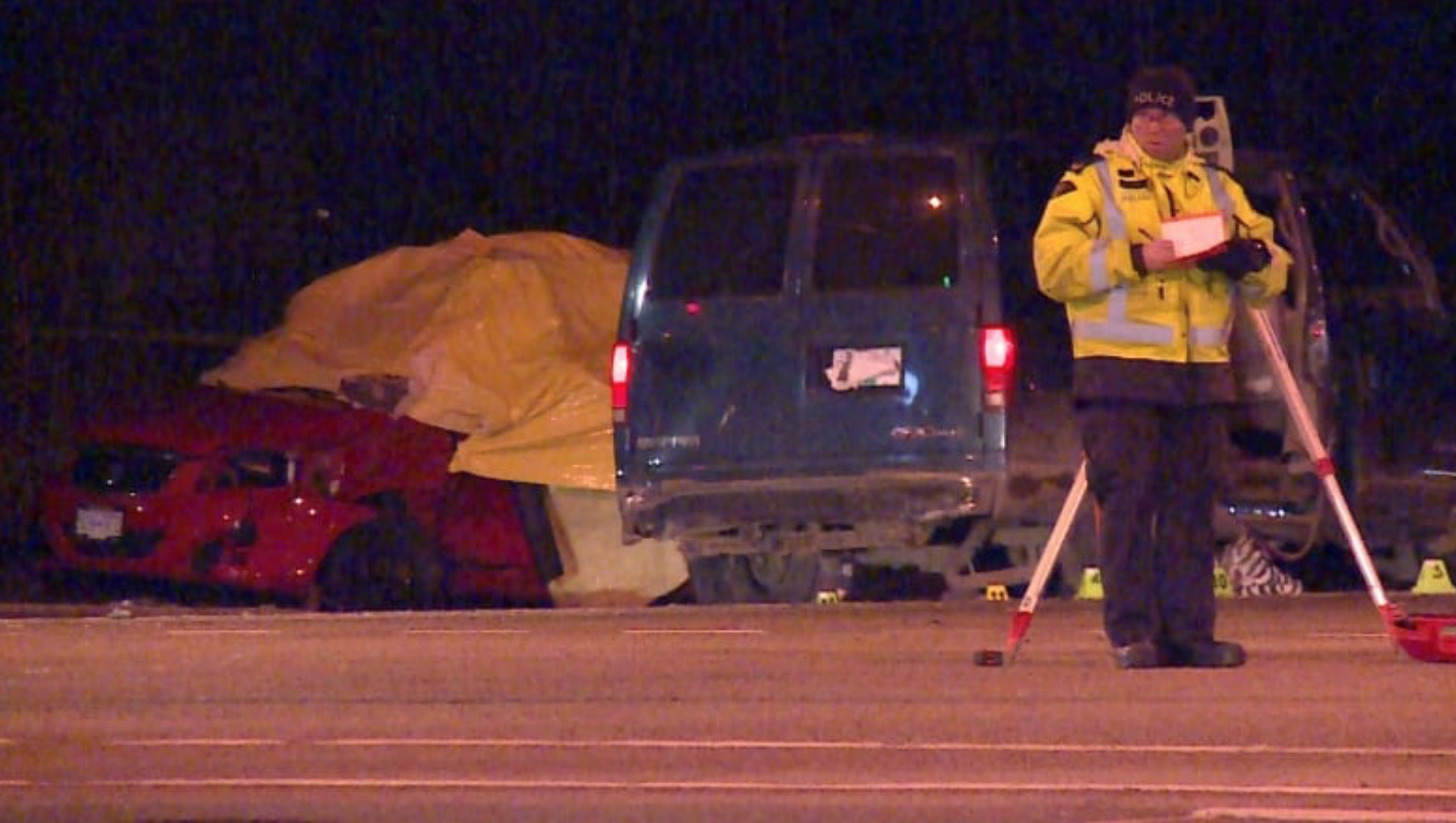 Collision investigators photograph the scene of the hit and run on 72nd Avenue. (Gian-Paolo Mendoza/CBC)