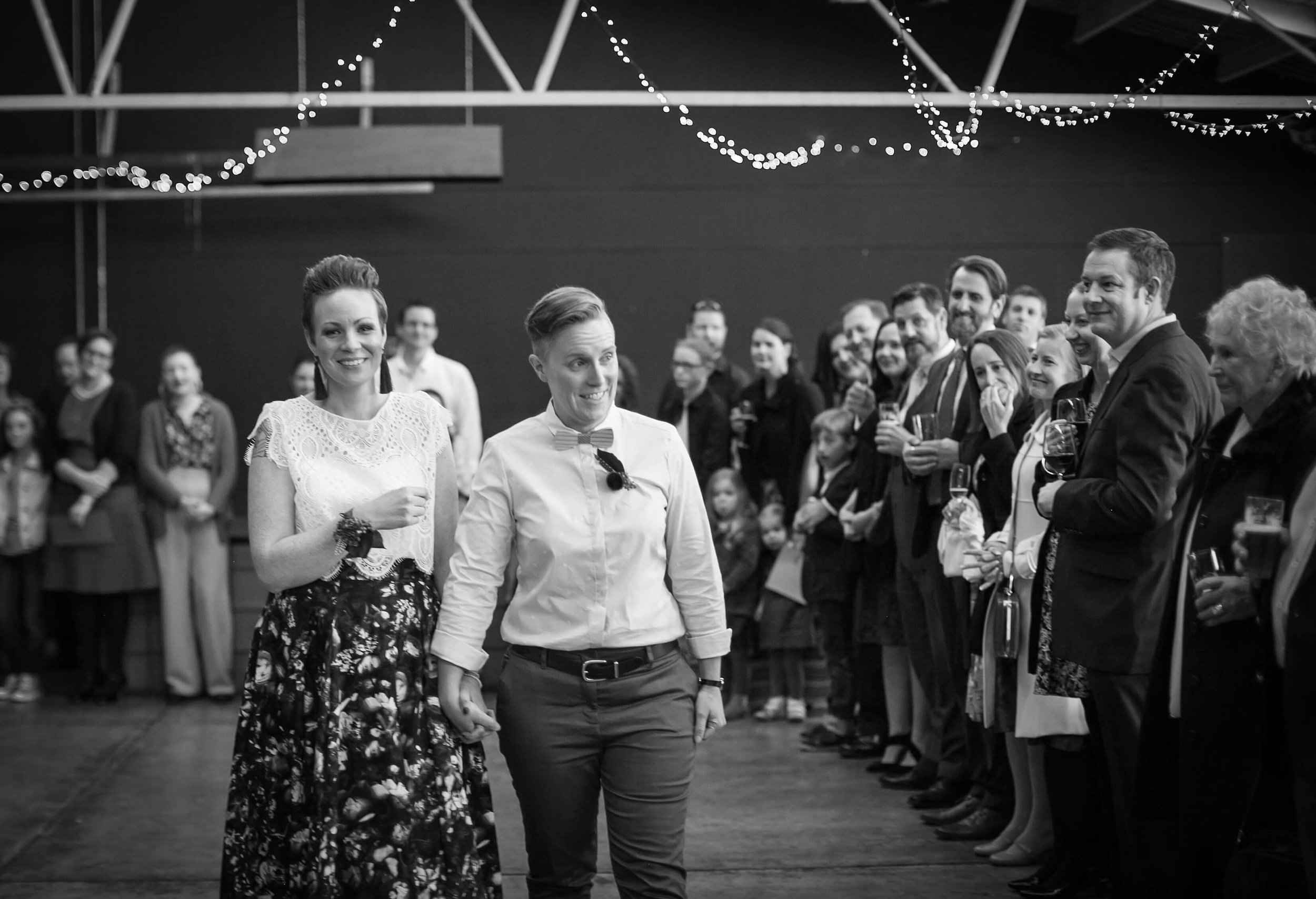 Guests line the entrance for Amy and Lee. Photo credit: Alex Road Photography