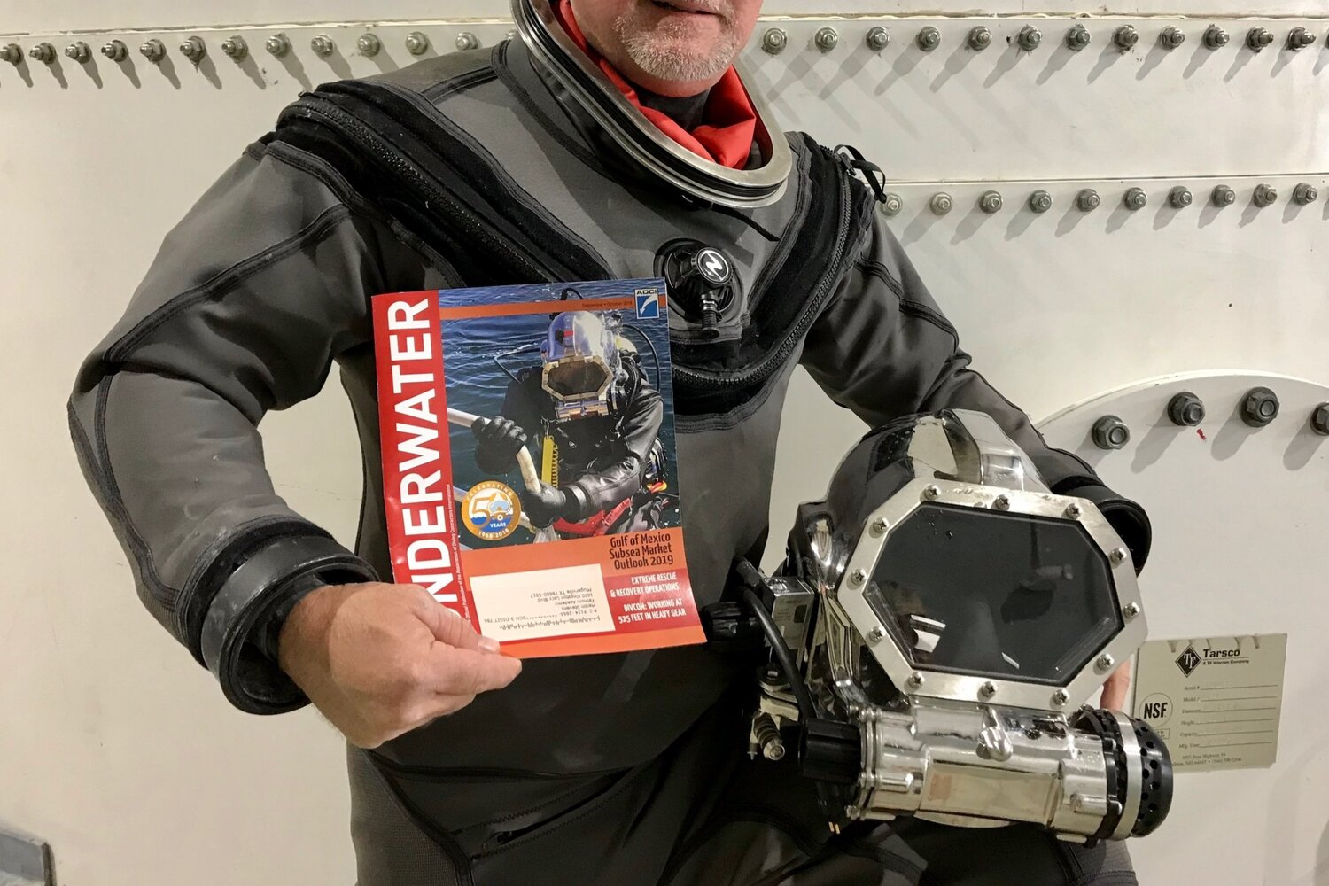 Opifex Global's first underwater space training suit was custom-made by Aqualung; the helmets were provided by Gorski. The training suit made the cover of Underwater Magazine.