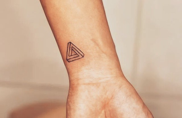 23-Tattoo-on-the-wrist-of-the-girl-a-triangle.jpg