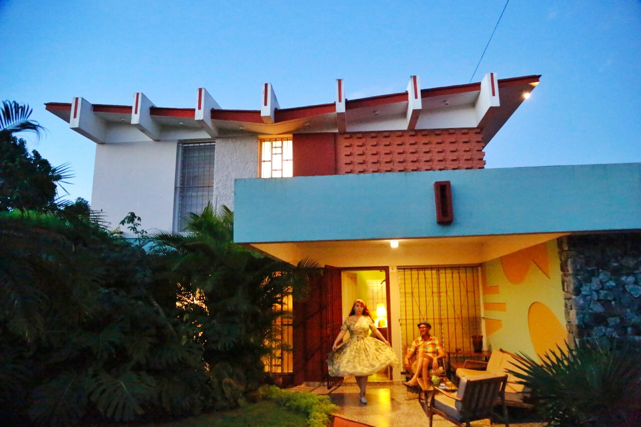 Nicole and Jonathan enjoy an evening outside a mid-century house in Cojimar.