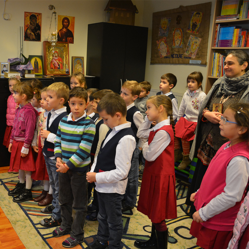The children in the Holy Hierarch Nicholas primary school sing a welcoming song for Fr.Teofan Mada and David Goa -