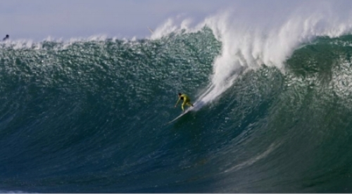 Surfer catching a ride on the infamous Mavericks.