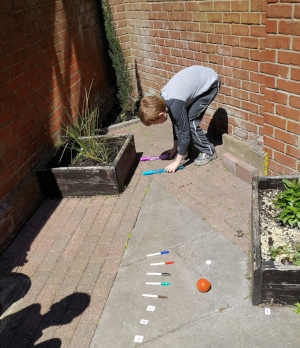 Joseph (year 4) creating his own hand gym assault course to aid his fine motor skills for handwriting.