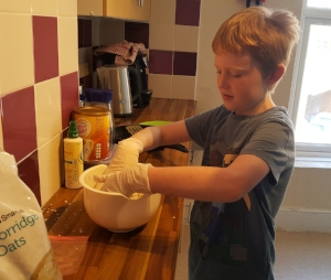Joseph (year 4) during a cooking session.