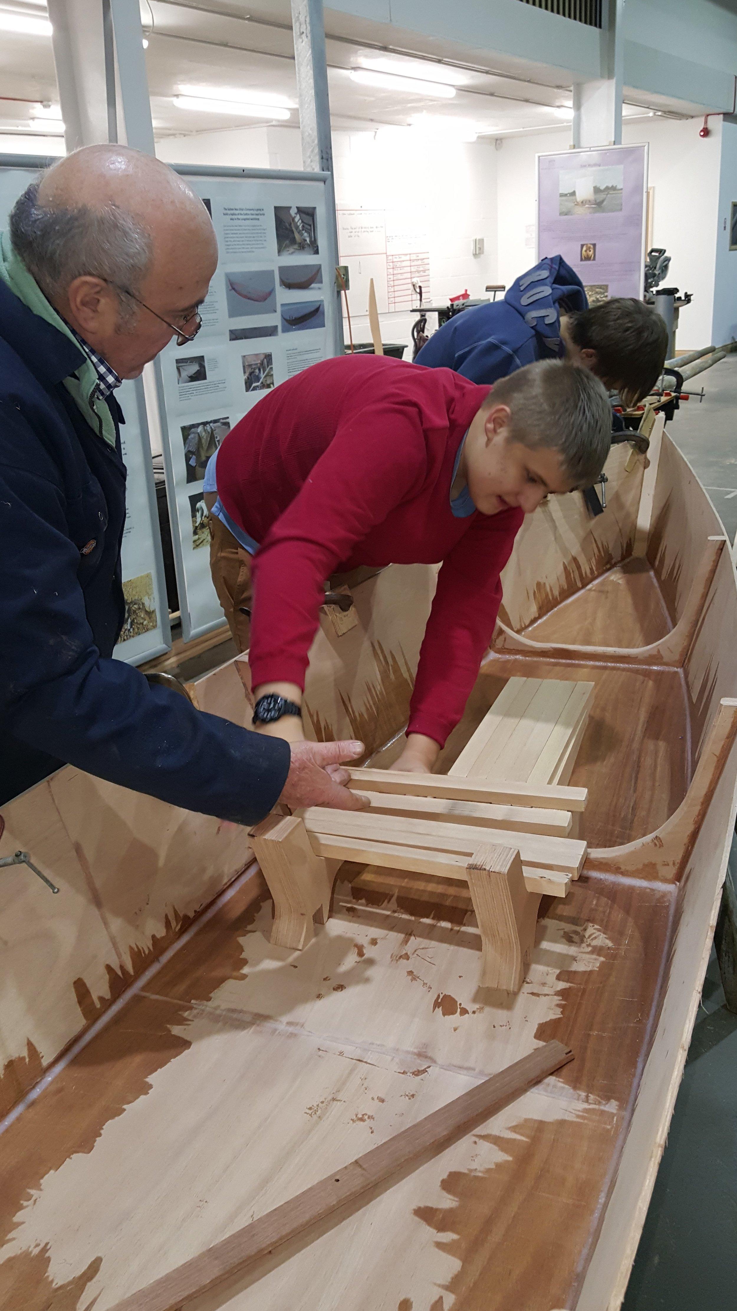 Leo (year 11) working on the canoe building project, Woodbridge.
