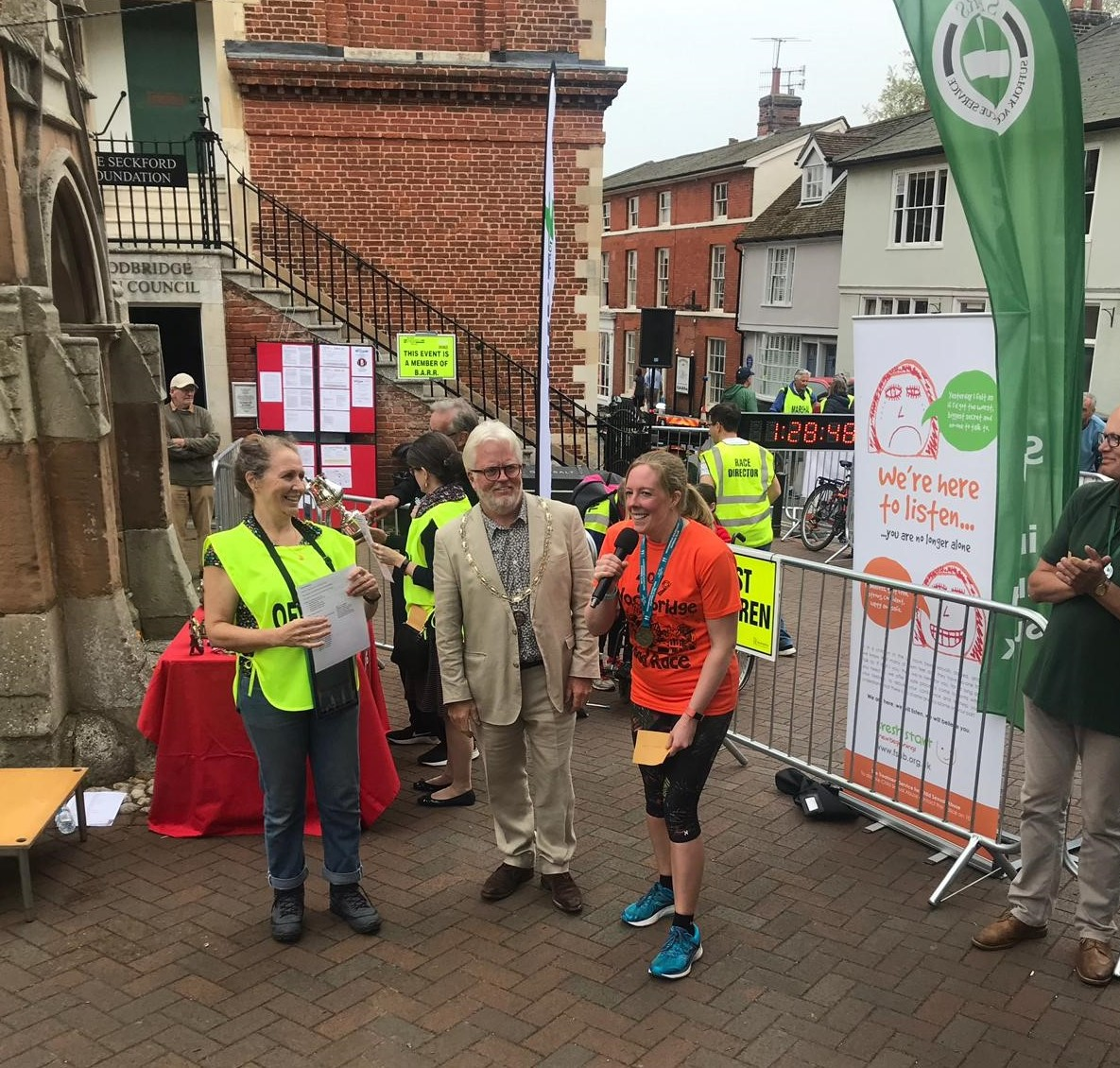 Lapwing's very own Lisa Squirrell accepting a cheque from Woodbridge Shufflers following the Woodbridge 10KM run (19 May 2019).