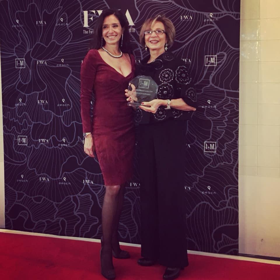 I-M Magazine editor Julia Pasaron with my mother Sedigheh Mohammadi accepting my award on my behalf