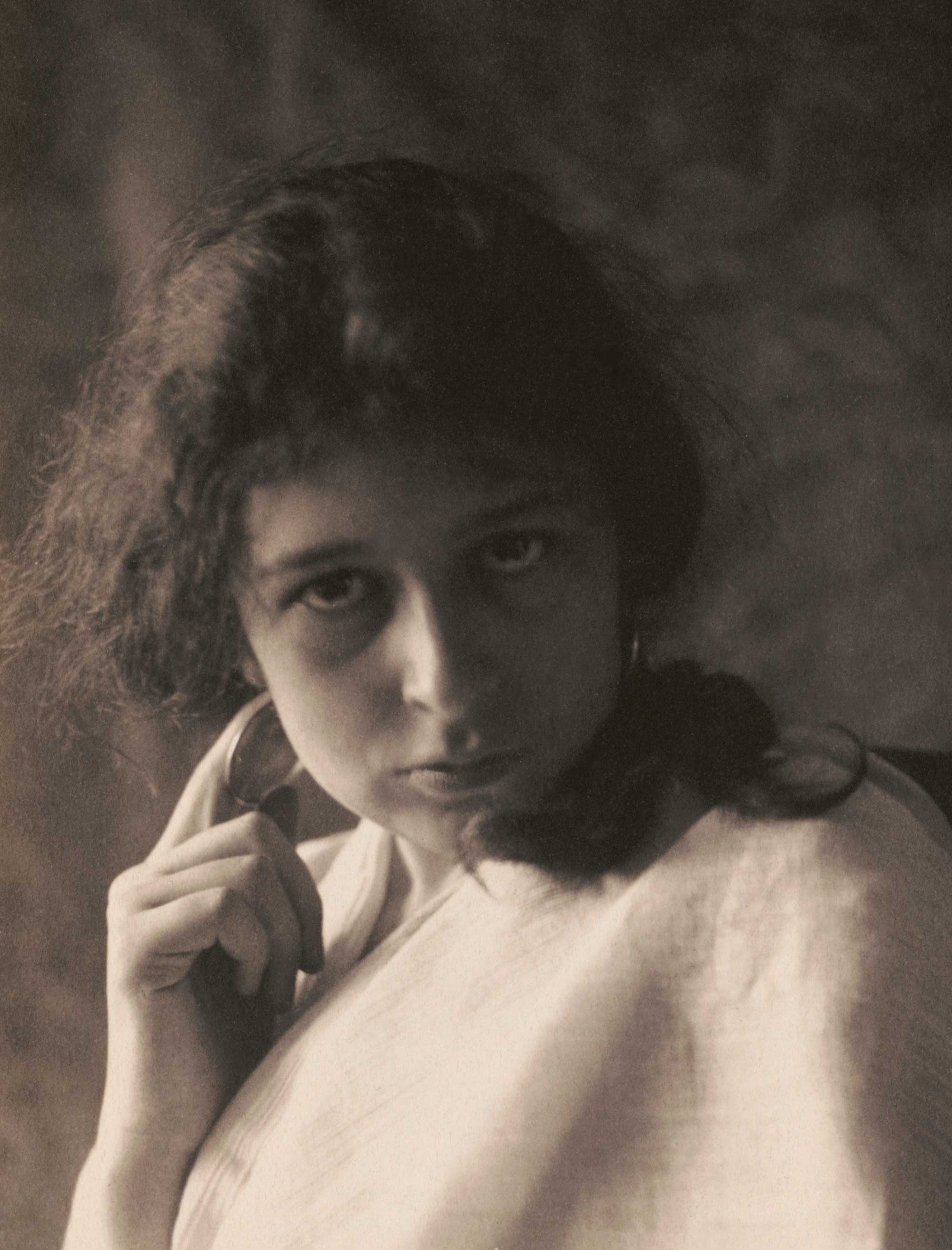 c. 1898: 'Woman in drapery with hoop earrings'