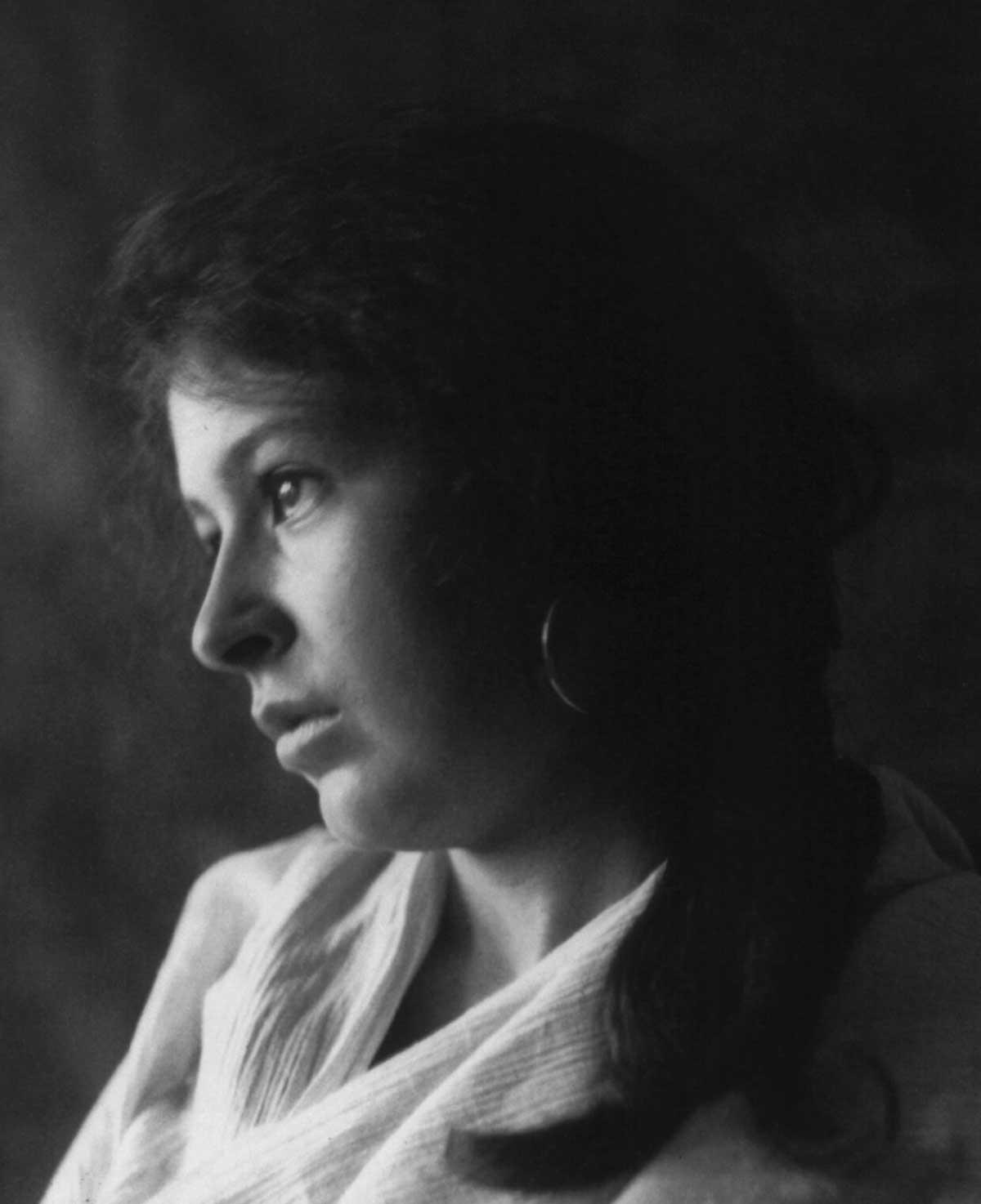c. 1898: Woman in drapery with hoop earrings
