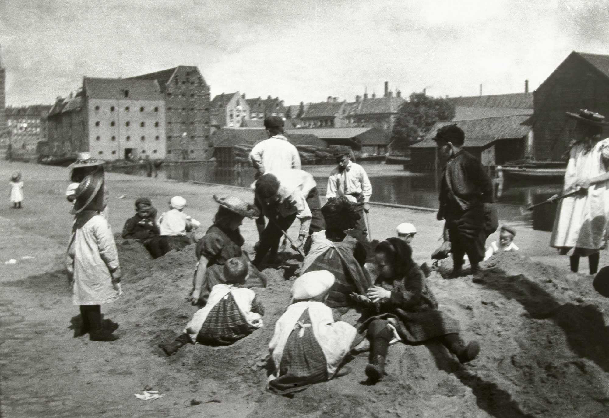 Children play in a sand dump near Prince Island.