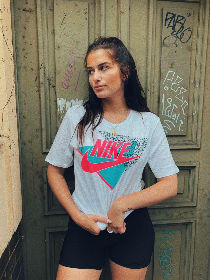 THIS   NIKE T-SHIRT   IS GIVING ME RETRO, SNEAKER BOX VIBES AND I'M HERE FOR IT. I WOULD PROBABLY PAIR THIS WITH CYCLING SHORTS LIKE IN THE PIC AND ADD SOME STRAPPY SANDALS AND A BUM BAG FOR NIGHT TIME.