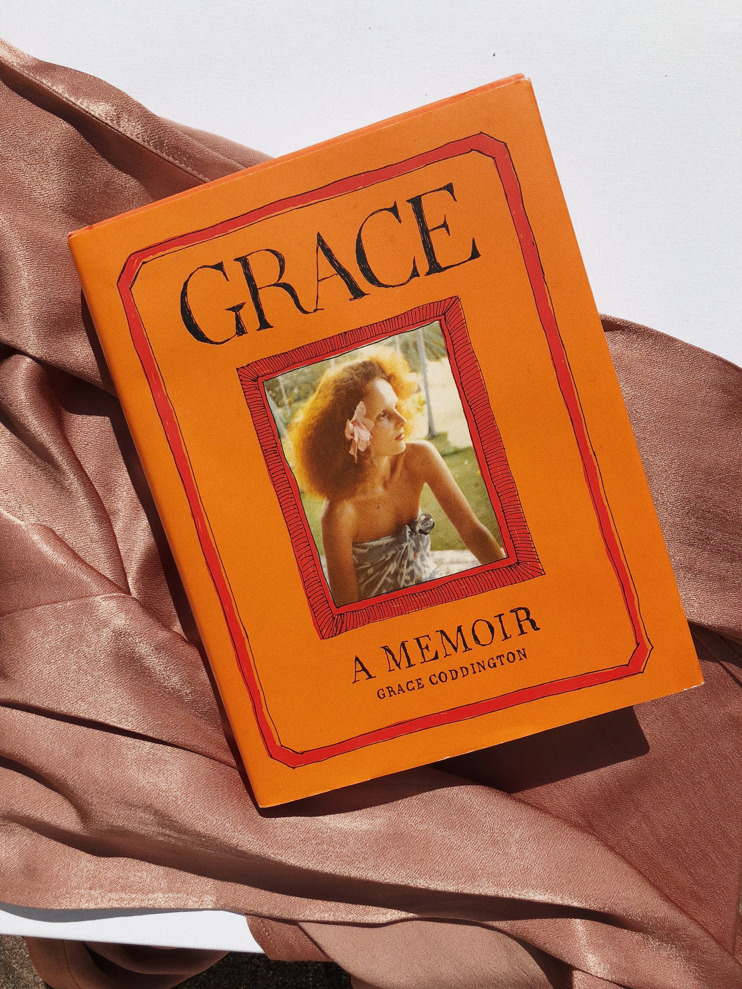 I THNK LIKE EVERYONE, I LOVED GRACE IN THE SEPTEMBER ISSUE DOCUMENTARY. THIS   BOOK   IS HER STORY AND IT'S BEAUTIFULLY WRITTEN, SMART AND FUNNY - THE POP OF ORANGE LOOKS SO GOOD ON THE COFFEE TABLE AS WELL. IT MAKES SUCH A GREAT GIFT FOR FASHION LOVERS, TOO! -J