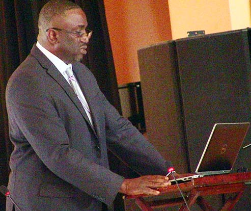 Honourable Minister of Finance presenting the budget for 2015.  Photo Credit: The Montserrat Reporter