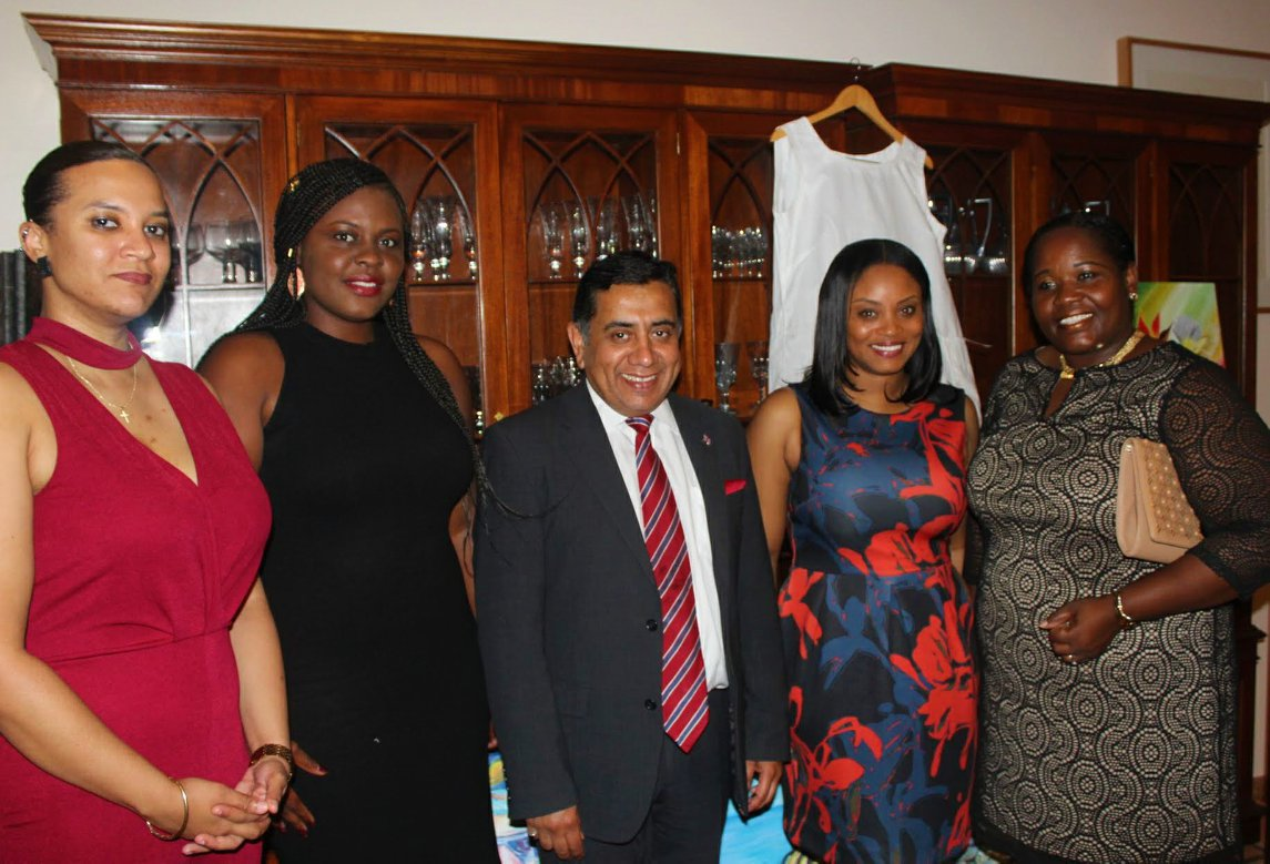 Lord Ahmad poses with Deputy Premier Hon. Delmaude Ryan and Chevening Alumni  Photo Credit: HM Governor's Office