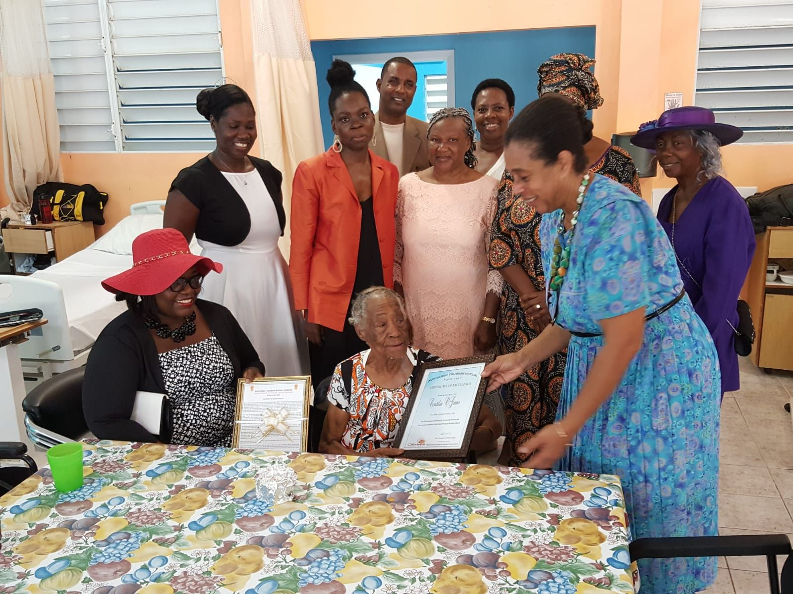Mrs Cintelia O'garro with the Minister with responsibility for Culture and Members of the Calabash Committee