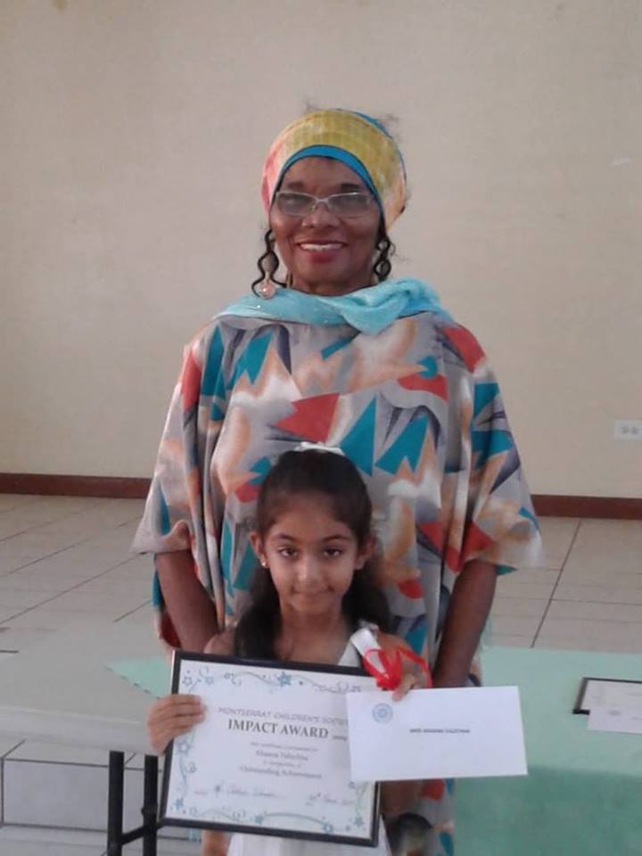 Ahanna receiving her award from Ms Rose Willock.  Photo Credit: Agnes Lempiere