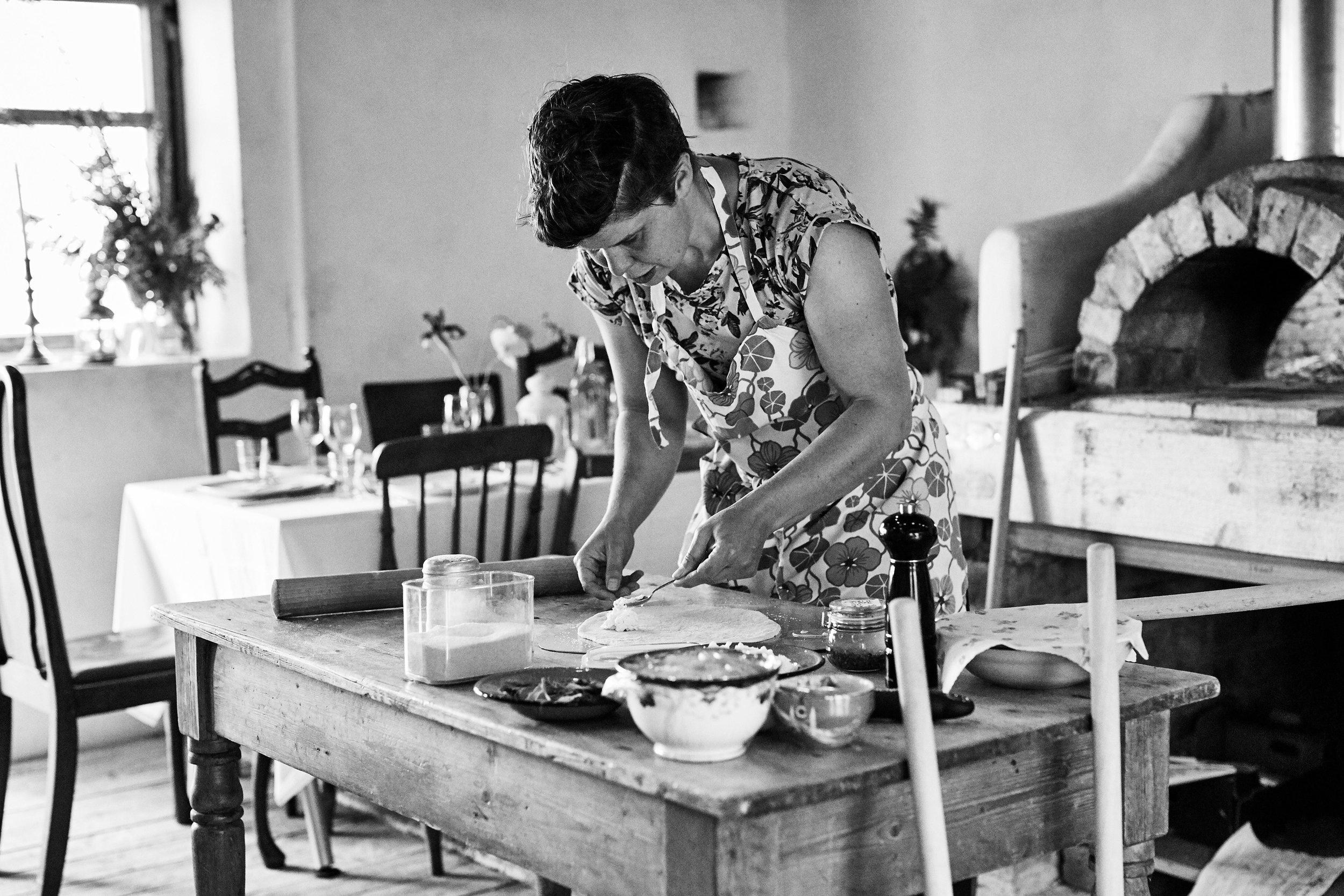 Jo working her magic on some flatbread dough