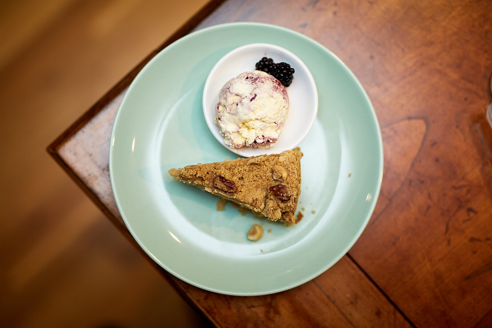 Apple and cinnamon streusel cake with blackberry and bay ice cream