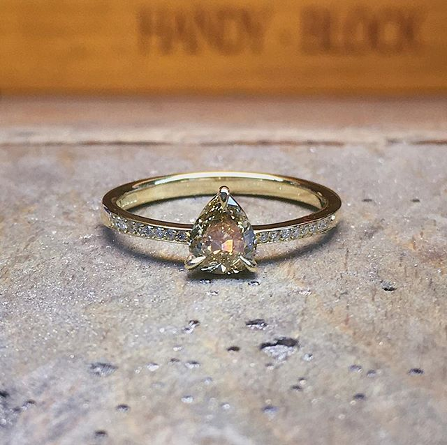A sweet little yellow gold and yellow pear shaped diamond ring with white diamond shoulder stones #yellowdiamond