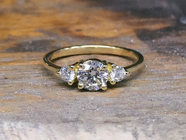 A dinky yellow gold three stone ring with white diamonds #trilogyring