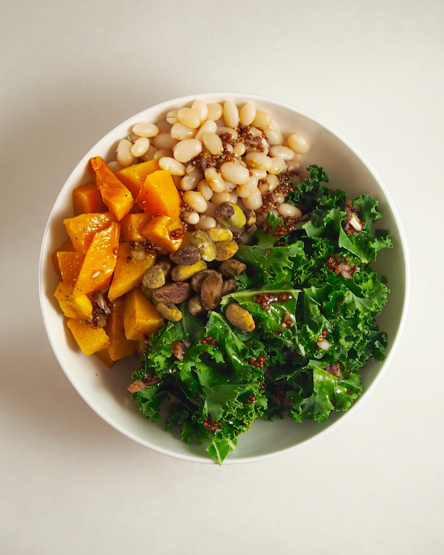 Registered Dietitian Nutritionist approved recipe for roasted squash and kale salad with white beans.