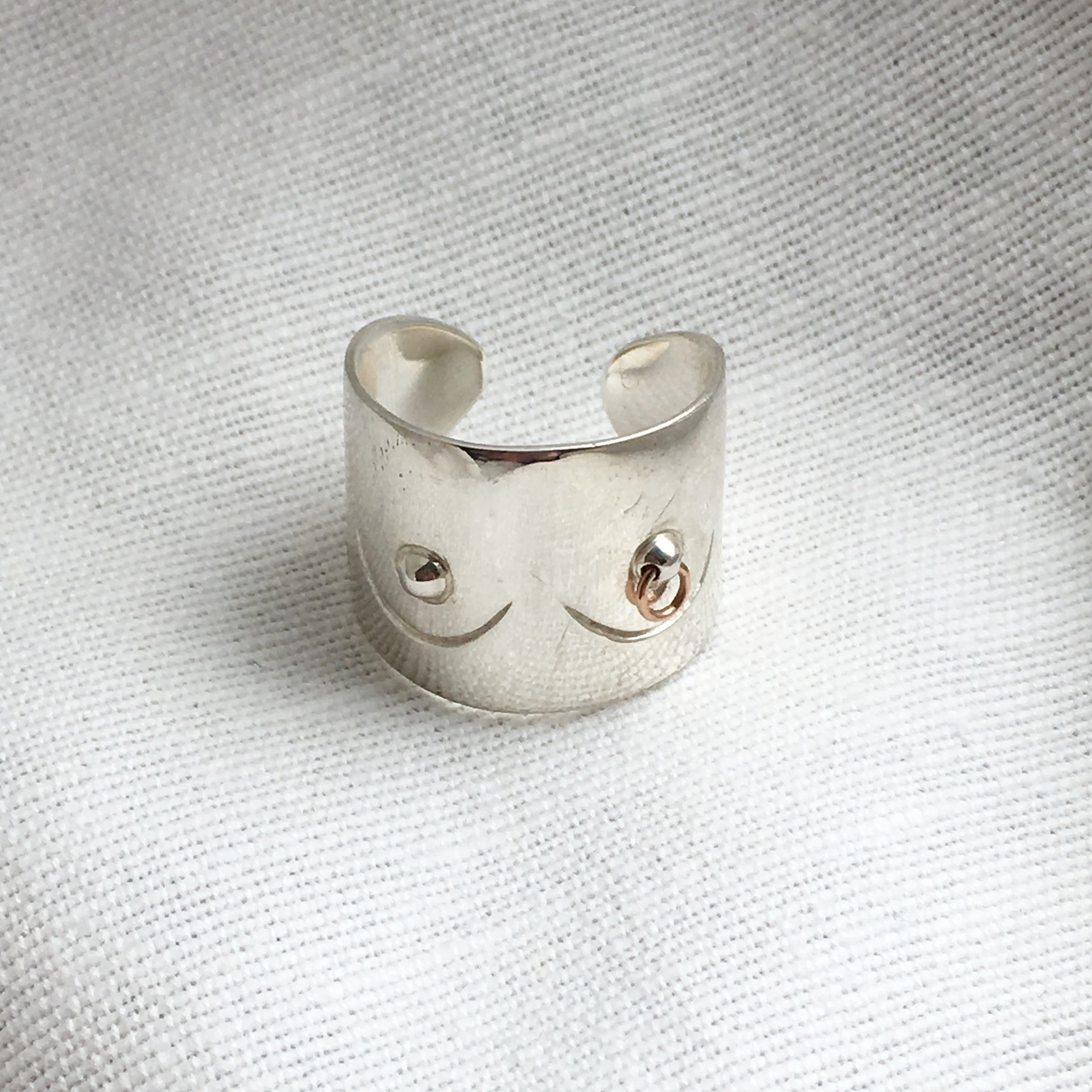 SILVER PIERCED BOOB RING WITH 14K ROSE GOLD PIERCING