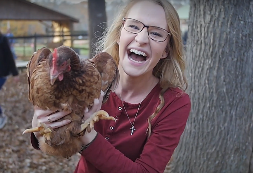 girl with chicken.png