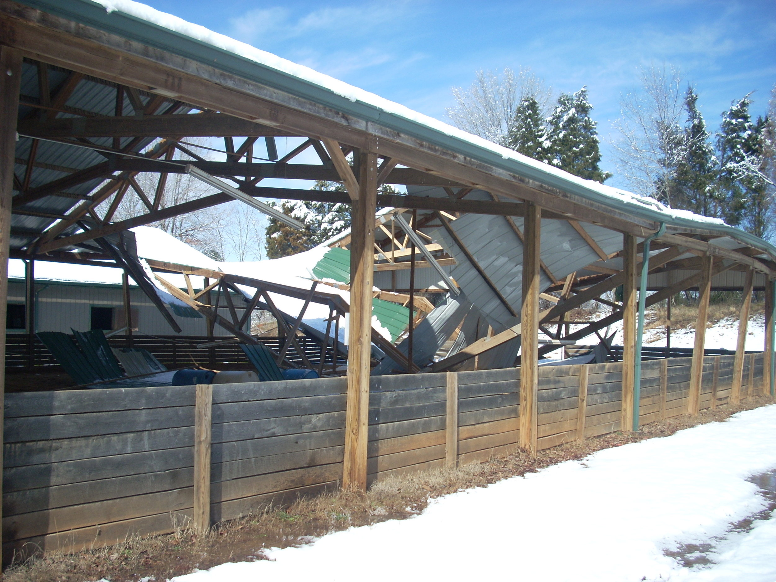 Roof collapse in the Large Covered Arena during a snow because arenas were not constructed to code before we moved in.