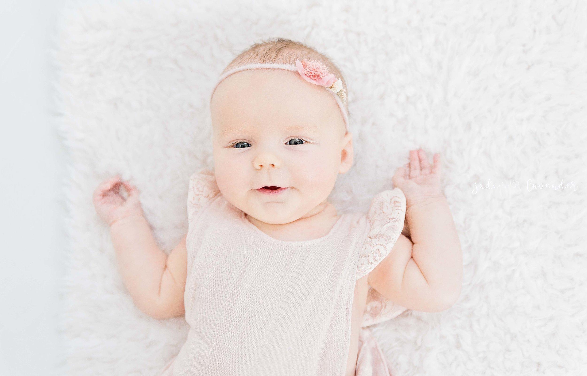 tummy-time-milestone-images-baby-photos-newborn-photography-pink-girl-spokane-washington.jpg