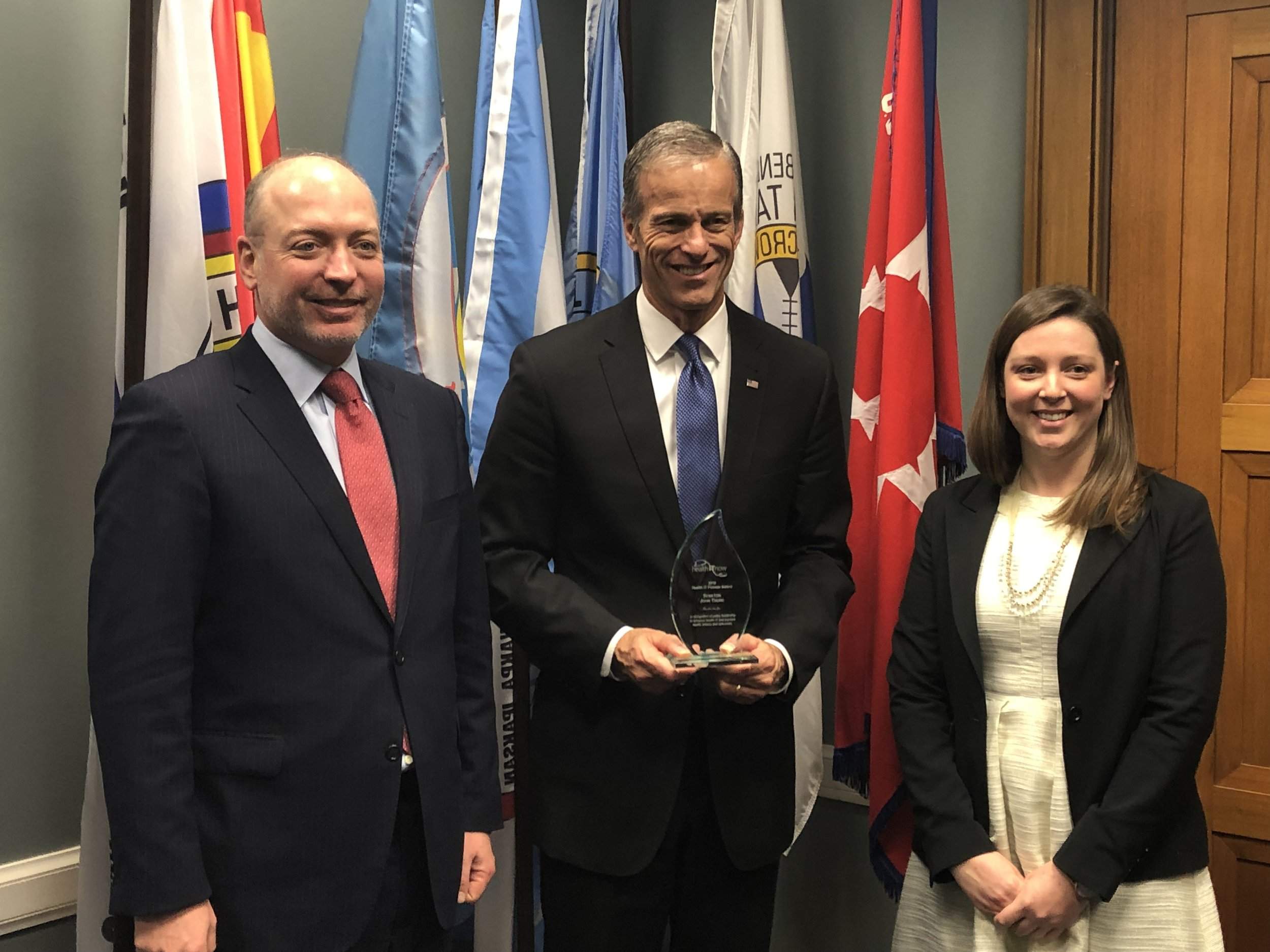 Sen. John Thune (R-SD) accepts the Health IT Pioneer award from Health IT Now Executive Director Joel White (left) and Senior Director of Government Affairs Catherine Pugh (right).