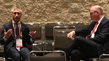 John Michael DeCarlo of IBM Watson (left) discusses being the value of a Health Innovation Alliance steering committee member with the coalition's Executive Director, Joel White (right)