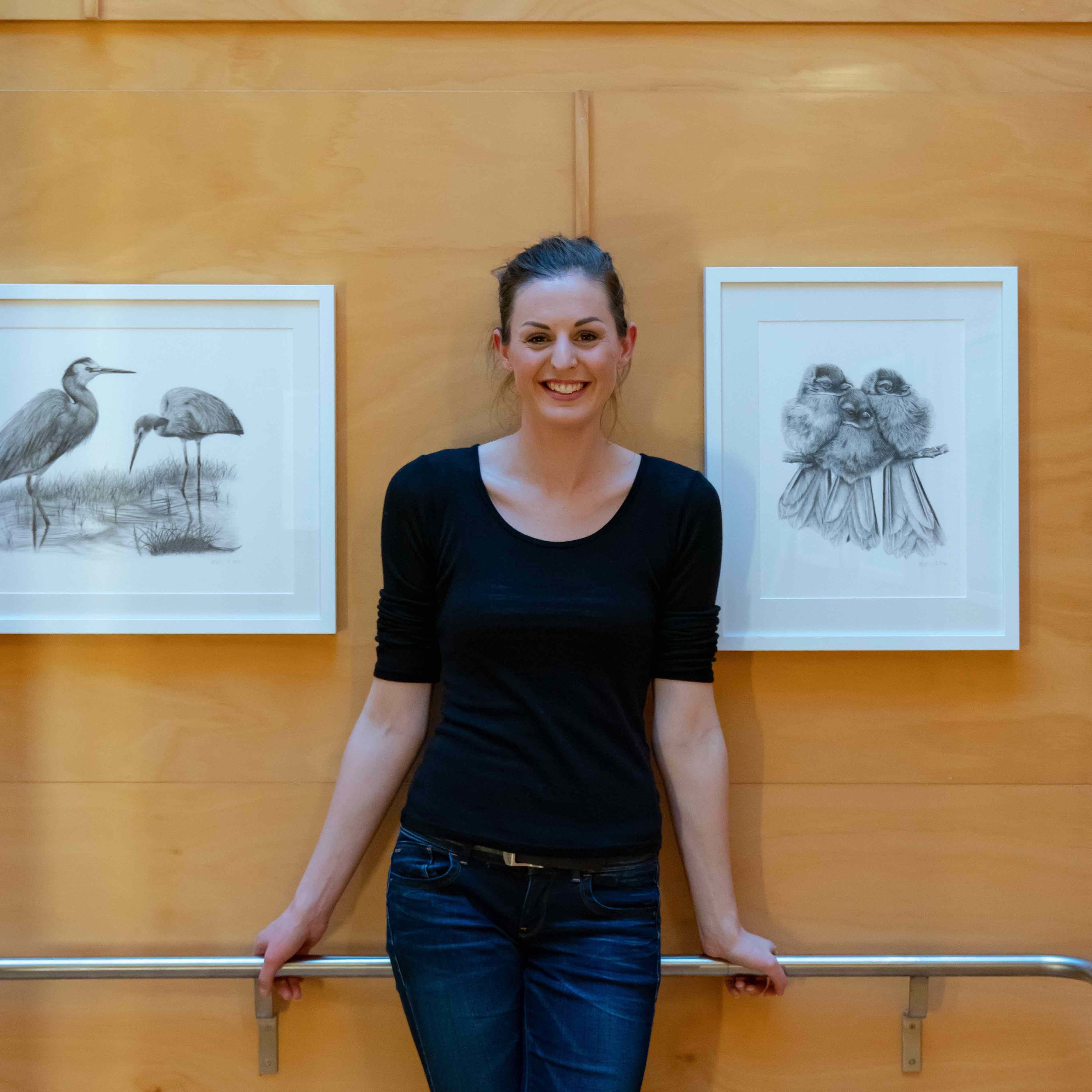 Hannah infront of her framed artwork at Zealandia.jpg