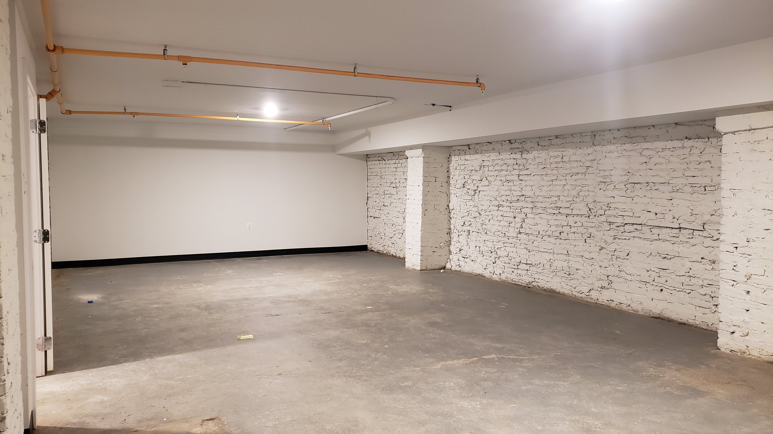 WHAT HAPPENED TO THE DUNGEON?  SorryNotsorry, our once-very-creepy basement is now home to 8 lovely affordable studio spaces.