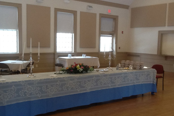Pilgrim Hall - Pilgrim Hall offers flexible space for meetings, social gathering, film screenings, fundraisers and other special events. Hardwood floors, trey ceilings, colonial chandeliers and numerous large windows make this a welcoming venue.