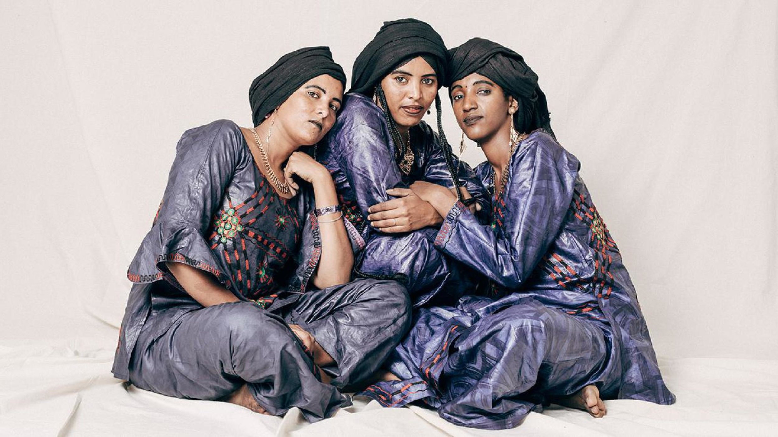 "LES FILLES DE ILLIGHADAD - ""The Girls of Illighadad"" are the first female Tuareg guitarists from Niger. Hailing from a small, isolated village on the Sahara where musical styles are divided by gender, their defiance of tribal norms has resulted in a breath-taking new sound that is mesmerizing audiences across the world. We are beyond thrilled to present them to you as part of their US debut tour."