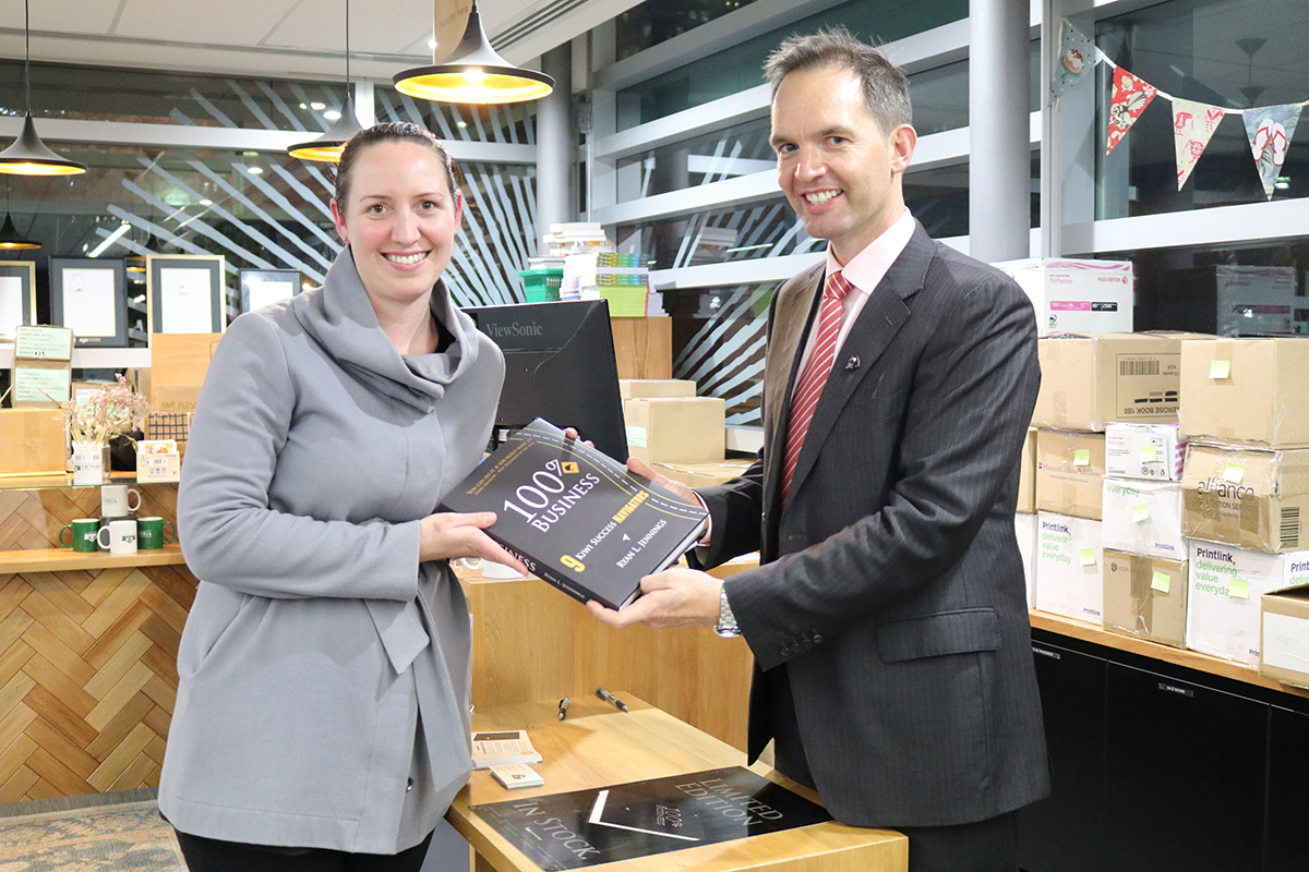 Rachel Thacker Engagement Manager purchasing the 100% Kiwi Business book for the Victoria Business School library in Wellington.