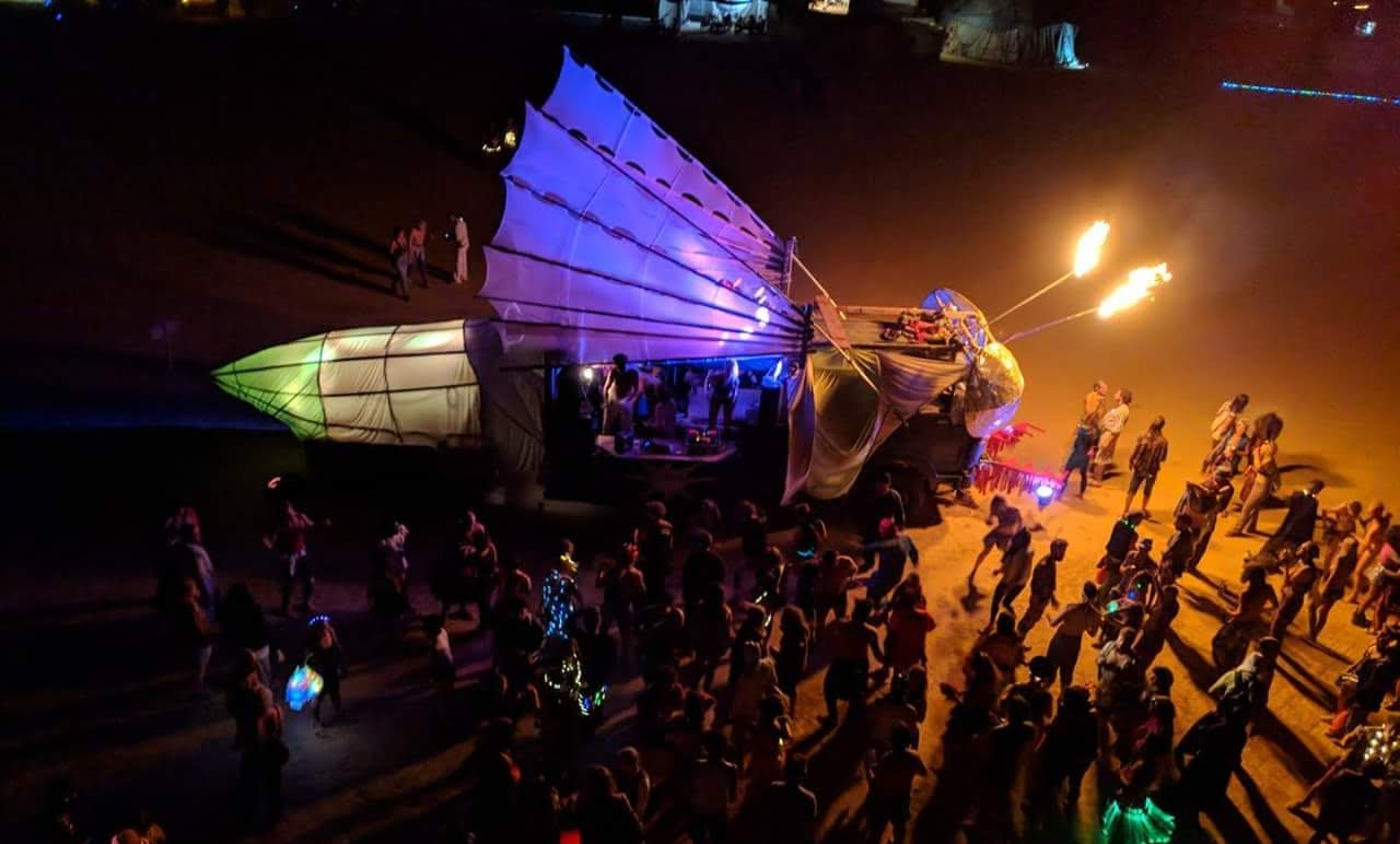Sharing cacao at Nowhere Festival, fueling parties and connecting in check-in circles to co-create to the fullest. Resulting in art projects like this firefly art car.
