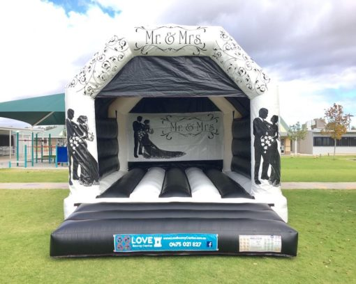 MR AND MRS LARGE BOUNCY CASTLE $349