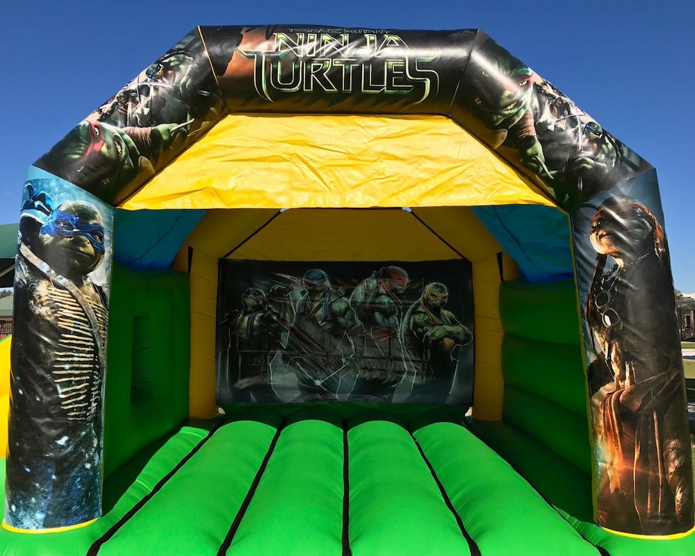 Teenage Mutant Ninja Turtles bouncy castle hire with slide Mandurah