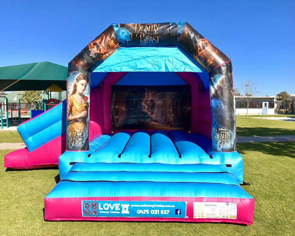 Beauty and the beast bouncy castle hire with slide Baldivis