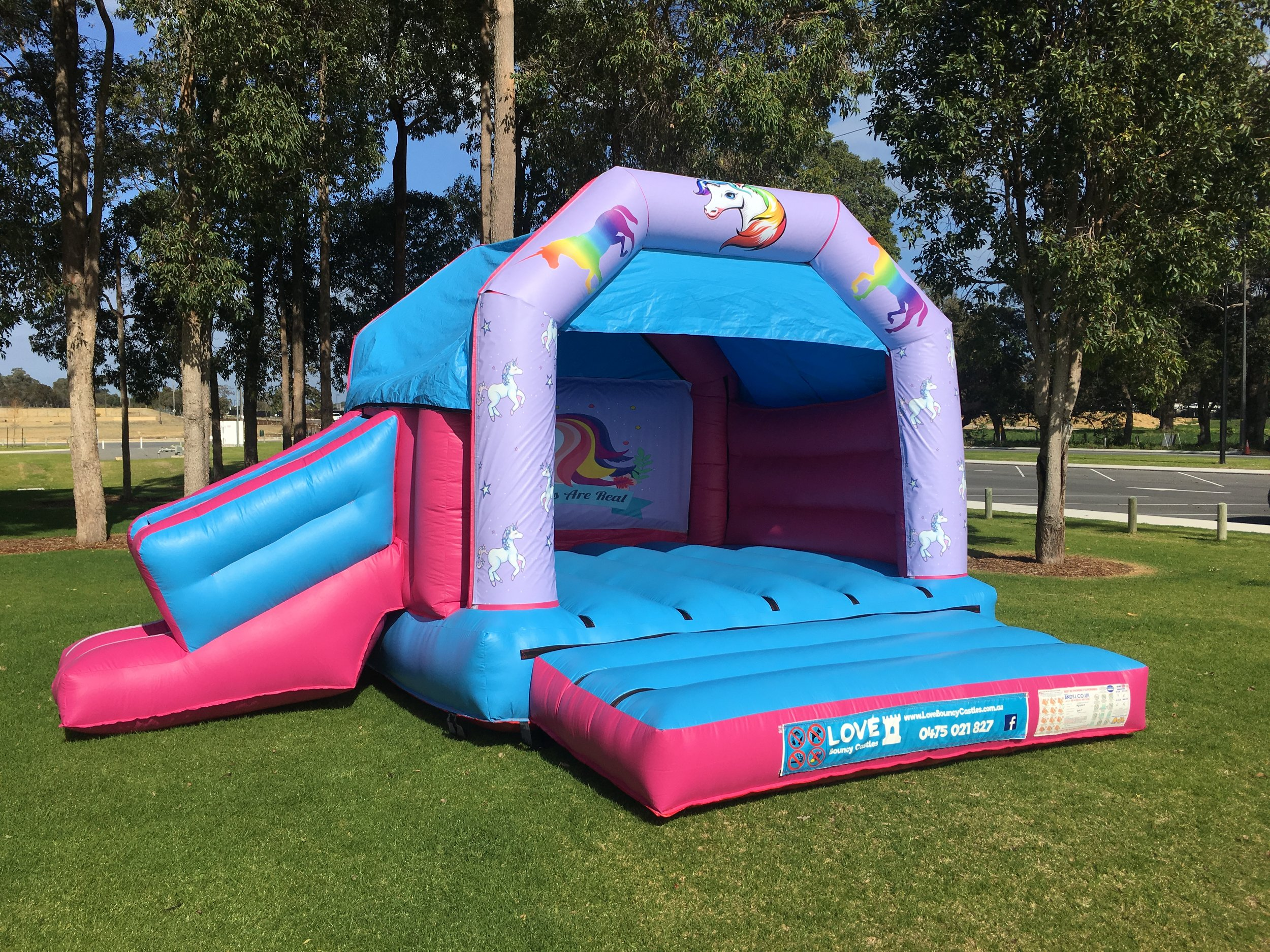 Unicorn bouncy castle hire with slide Rockingham