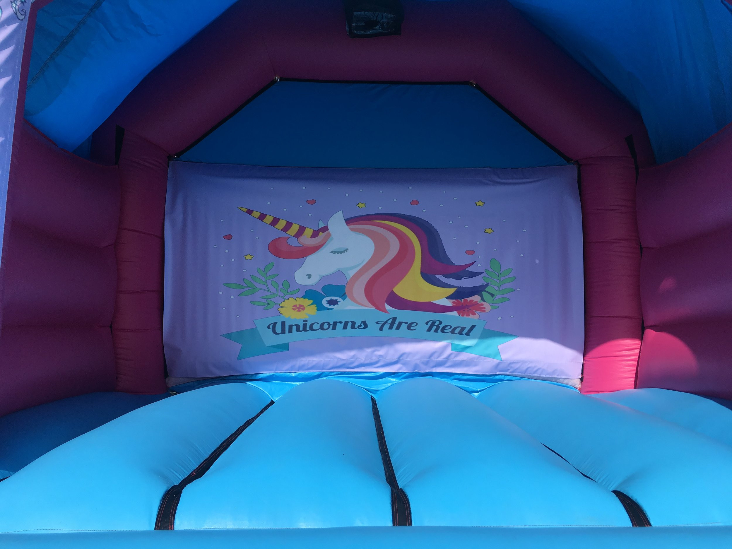 Unicorn bouncy castle hire with slide Mandurah
